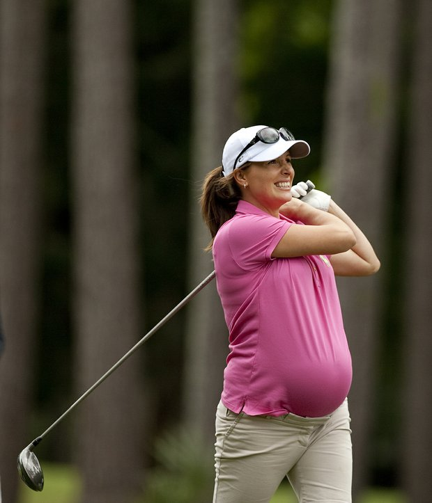 Nel-Mare, wife of Louis Oosthuizen tucks her shirt in, over her pregnant belly, during the PGA Tour Wives Golf Classic.