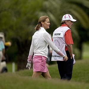 PGA Tour Commissioner Tim Finchem caddied for his wife, Holly during the PGA Tour Wives Golf Classic on Dye's Valley Course.