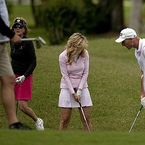 Jim Furyk gives his wife, Tabitha, a quick lesson during the PGA Tour Wives Golf Classic.