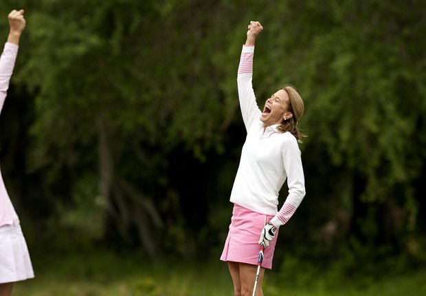 Holly Finchem wife of PGA Tour Commissioner Tim Finchem celebrates her putt at No. 2 during the PGA Tour Wives Golf Classic.