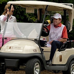 PGA Tour Commissioner Tim Finchem with his wife Holly at the PGA Tour Wives Golf Classic.