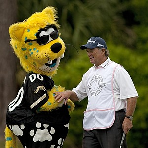 Jaxson de Ville of the Jacksonville Jaguars kids around with Peter Jacobson who caddied for his wife Erika during the PGA Tour Wives Golf Classic.
