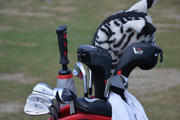 Charl Schwartzel's zebra driver headcover watches over his Nike VR Pro Blade irons.