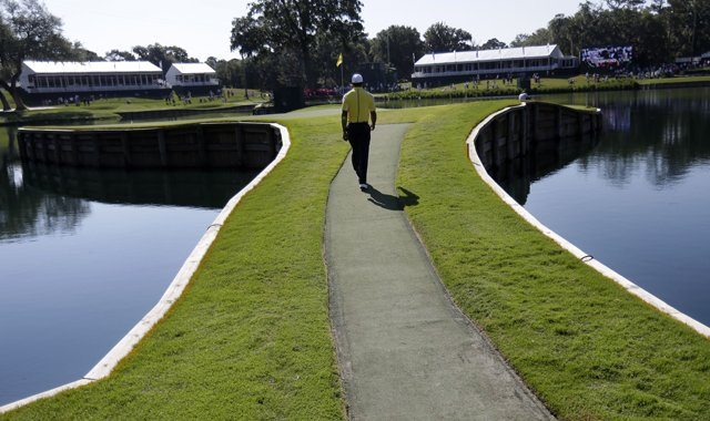 Tiger Woods walks to the 17th hole&#39;s island green at TPC Sawgrass in Ponte Vedra Beach, Fla., during practice for the 2013 Players Championship.