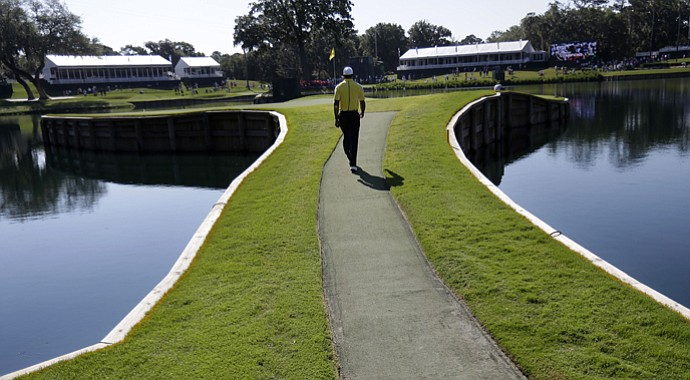Tiger Woods walks to the 17th hole's island green at TPC Sawgrass in Ponte Vedra Beach, Fla., during practice for the 2013 Players Championship.