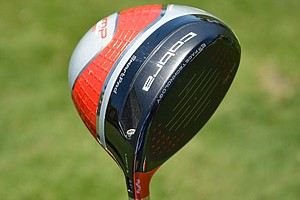 Rickie Fowler opts for an orange Cobra AMP Cell Pro driver to honor his alma mater, Oklahoma State.