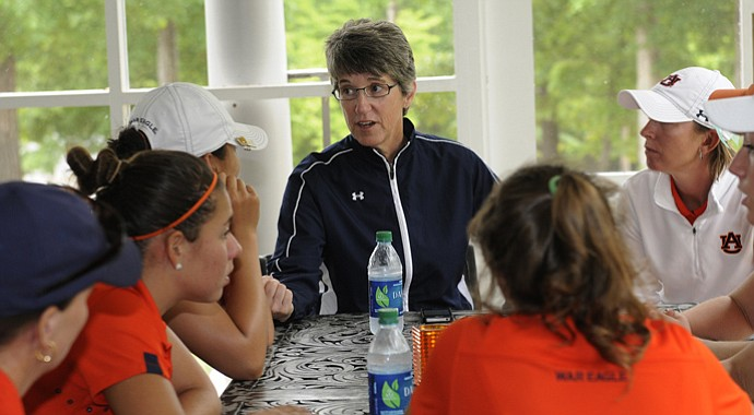 Auburn head coach Kim Evans talks to her players after advancing to the NCAA Championships out of the East Regional.