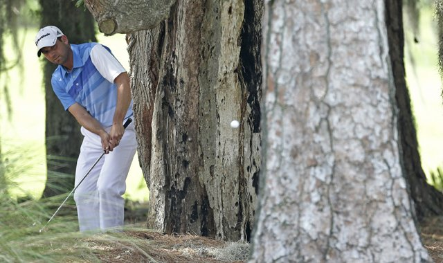 Sergio Garcia hits from the trees in the rough of the second hole during the third round of The Players Championship. This is where is ball ended up after Tiger Woods pulled his 3-wood from his bag and the crowd cheered.