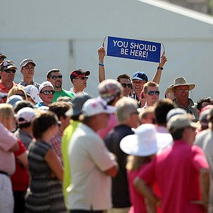 A spectator raises a sign while following Tiger Woods in the final round of the 2013 Players Championship at TPC Sawgrass.