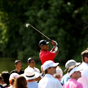 Tiger Woods hits his tee shot at No. 10 in the final round of the 2013 Players Championship at TPC Sawgrass.