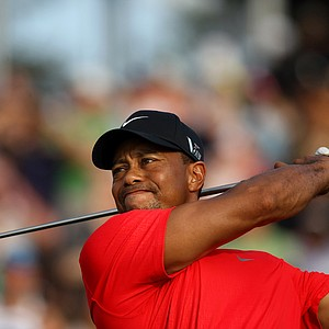Tiger Woods hits his tee shot at No. 18 in the final round of the 2013 Players Championship at TPC Sawgrass.