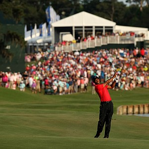 Tiger Woods hits his second shot at No. 18 in the final round of the 2013 Players Championship at TPC Sawgrass.