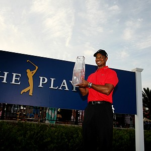 Tiger Woods holds the crystal trophy after winning the 2013 Players Championship at TPC Sawgrass.