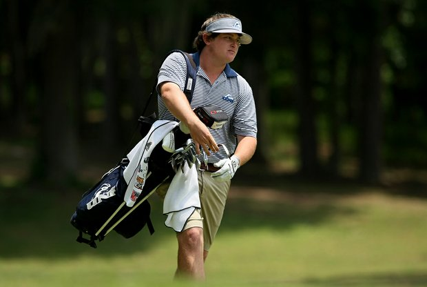 North Florida's M. J. Maguire posted a 65 in Round 1 at the Division 1 Men's Regional at Golden Eagle Country Club in Tallahassee.