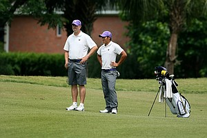 Washington's Cheng-Tsung Pan with coach Matt Thurmond at the Division 1 Men's Regional at Golden Eagle Country Club in Tallahassee.