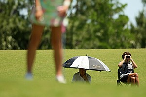 Annie Dulman's parents watch from greenside during the Division 2 Women's Final in Daytona Beach.