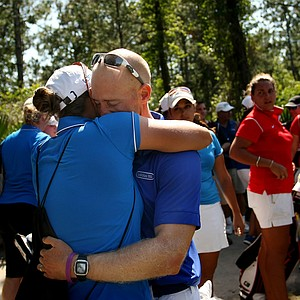 Danny Randolph, head coach of Lynn University, hugs his wife, Peggy after Lynn the Division 2 Women's Final in Daytona Beach.