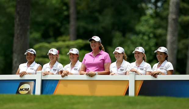 Mississippi State head coach Ginger Brown-Lemm poses with her team and assistant coach, Leigh Phillips during Monday's practice round at the Women's 2013NCAA Championship. this is their first ever appearance.