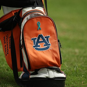 A ribbon for head coach Kim Evans is on the Auburn players' bags in Round 1 of the 2013 Women's NCAA Championship. Evans has ovarian cancer.