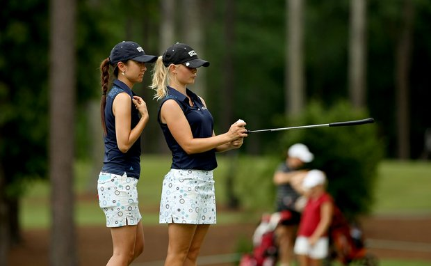 UCLA assistant coach Alicia Um-Holmes, left, consults with Louise Ridderstrom about her putt at No. 9 in Round 1.