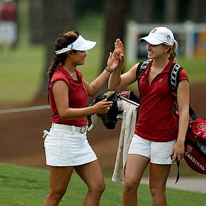 Stanford's Mariko Tumangan, left, gets a high five from teammate Danielle Frasier in Round 1. She posted a 71.