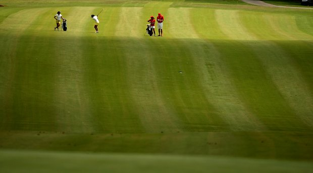 Players in the fairway at No. 18 in Round 1 of the 2013 Women's NCAA Championship.