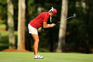Oklahoma's Kaitlyn Rohrback uses a long putter during the 2013 Women's NCAA Championship.