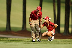 Oklahoma assistant coach Gerrod Chadwell with Anne-Catherine Tanguay in Round 1 of the 2013 Women's NCAA Championship.
