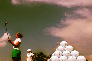 Michigan State's Trisha Witherby hits balls on the range in Round 1 of the 2013 Women's NCAA Championship.
