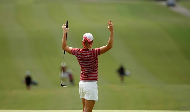 Oklahoma's Taylor Schmidt signals back to her teammate at No. 9 in Round 2 of the 2013 Women's NCAA Championship. Rohrback uses a long putter.