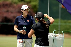Alabama assistant coach Susan Rosenstiel greets Auburn coach Kim Evans after she arrived in Round 2 of the 2013 Women's NCAA Championship. Evans was diagnosed with ovarian cancer during the NCAA East Regionals.