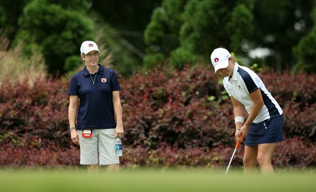 Auburn head coach Kim Evans works with a player in Round 2 of the 2013 Women's NCAA Championship. Evans was diagnosed with ovarian cancer during the NCAA East Regionals.