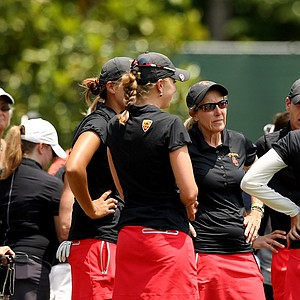 USC head coach Andrea Gaston talks with her players after they took the lead after the morning wave in Round 2 of the 2013 Women's NCAA Championship.
