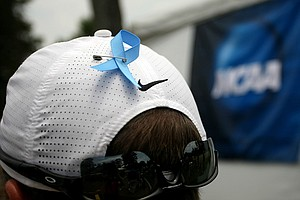 Oklahoma assistant coach, Gerrod Chadwell in Round 2 of the 2013 Women's NCAA Championship. Chadwell sports a ribbon on his hat for the Oklahoma tornado victims.