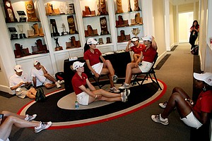 Stanford women hide from the rain in the lobby of the Boyd Center at University of Georgia Golf Course in Round 2 of the 2013 Women's NCAA Championship.