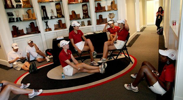 Stanford women hide from the rain in the lobby of the Boyd Center at University of Georgia Golf Course in the second round of the 2013 Women's NCAA Championship.