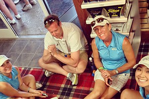 UCLA waits out the delay in the pro shop in Round 2 of the 2013 Women's NCAA Championship.