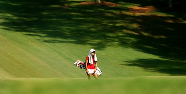 Wisconsin's Kimberly Dinh hides from the sun in Round 2 of the 2013 Women's NCAA Championship.