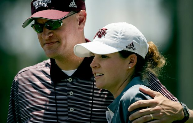 Mississippi State's Ally McDonald gets a hug from the athletic director, Scott Stricklin, in Round 3 of the 2013 Women's NCAA Championship.