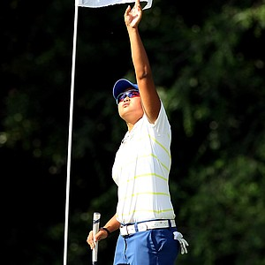 San Jose State's Regan De Guzman reaches for the flag in Round 3 of the 2013 Women's NCAA Championship.