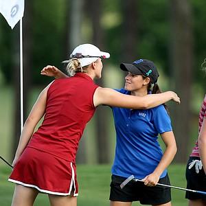 Duke's senior, Courtney Ellenbogen, center, hugs Alabama's senior, Jennifer Kirby, left, in Round 3 of the 2013 Women's NCAA Championship.