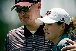 Mississippi State's Ally McDonald gets a hug from athletic director Scott Stricklin during the third round of the 2013 Women's NCAA Championship.