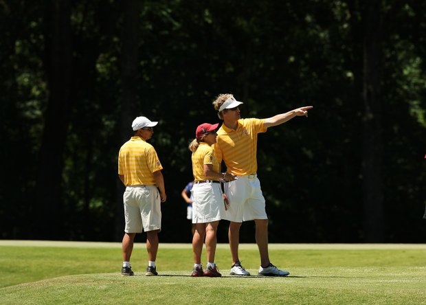 USC's head coach Andrea Gaston, center, talks with the athletic trainer, John Meyer in the final round of the 2013 Women's NCAA Championship.EEK)