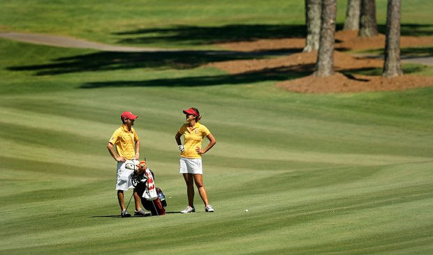 USC's Annie Park with assistant coach Justin Silverstein in the final round of the 2013 Women's NCAA Championship.