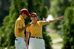 USC head coach Andrea Gaston with her assistant Justi Silverstein in the final round of the 2013 Women's NCAA Championship.