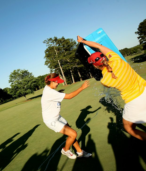 USC's Sophia Popov attempts to douse Annie Park in the final round of the 2013 Women's NCAA Championship.