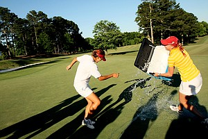 Sophia Popov attempts to douse Annie Park in the final round of the 2013 Women's NCAA Championship. Park is the seventh freshman to win the individual title.