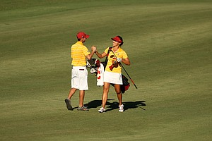 Annie Park and assistant coach Justin Silverstein celebrate in the fairway at No. 18 in the final round of the 2013 Women's NCAA Championship.