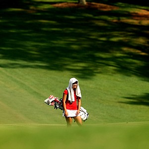 Wisconsin's Kimberly Dinh takes reprieve from the sun in Round 2.