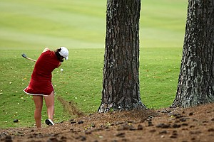 Alabama's Emma Talley hits from the trees and pine straw at No. 9 in Round 3.